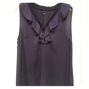 Ruffled neckline sleeveless blouse